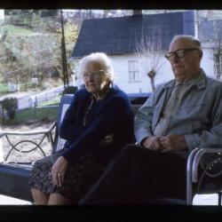 Mother and son sitting on porch