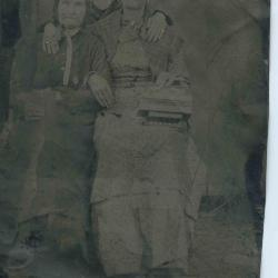 Two men in front of a coal mine