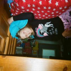 Girl in pajamas on bunk bed